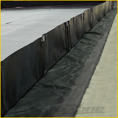 spill berm underlayment to protect against punctures